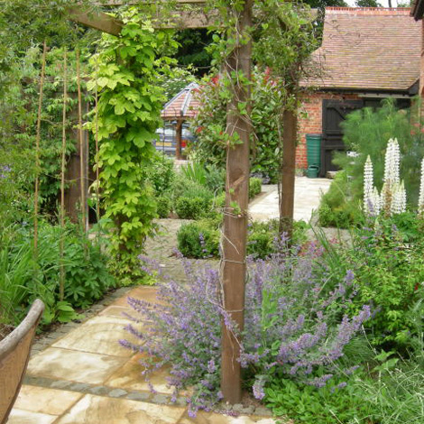A Pergola Seating Area And Feeding Mangers Were Transformed Into A Water Feature The Garden Was Completed With An Abundant Selection Of Cottage Garden